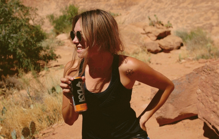 Drinking KYLA Kombucha in the Moab desert.