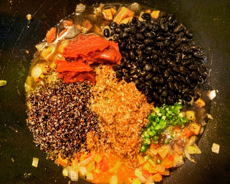 Leftover chili: quinoa, black beans, seasoned cauliflower, jalapenos, tomato paste, onions, squash, sweet potatoes
