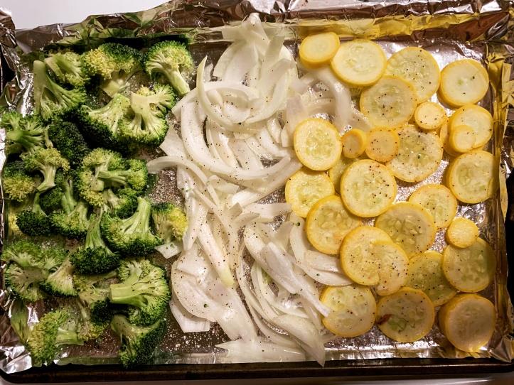 Baking veggies like broccoli, onions, and yellow squash