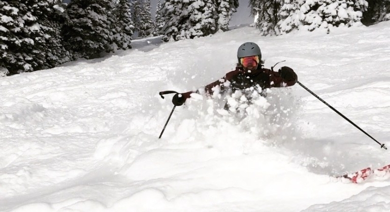skiing some powder on a bluebird day