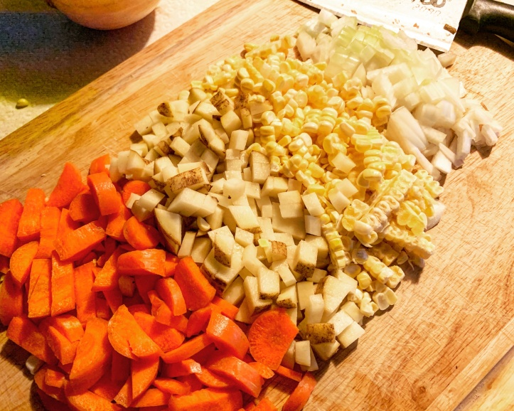 diced carrots, potatoes, corn, and onions