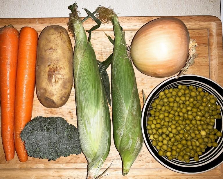 corn, carrots, potatoes, onions, broccoli. peas
