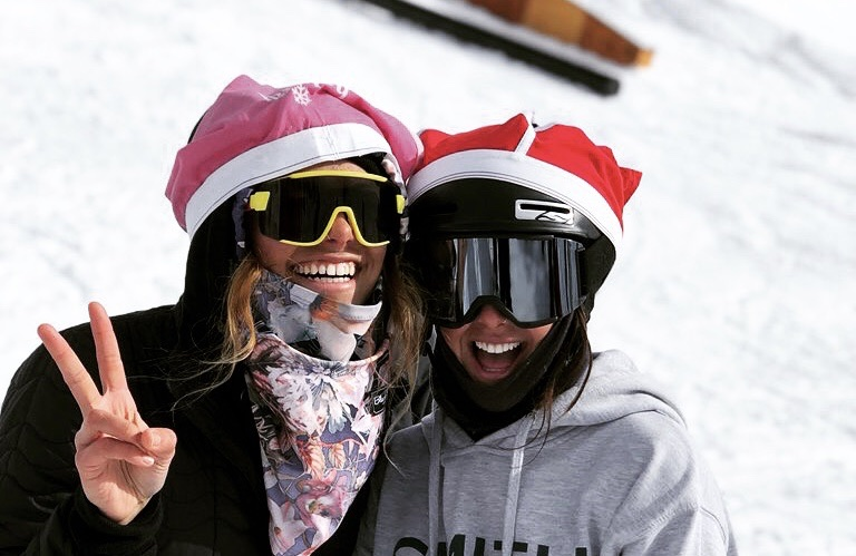 two friends skiing