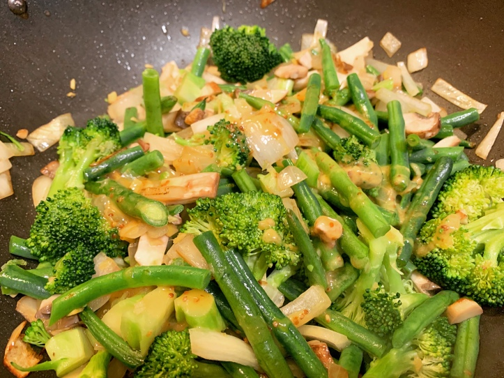 Plant-Based Ginger Soy Sauce Glaze With Broccoli and Green Beans ingredients in wok