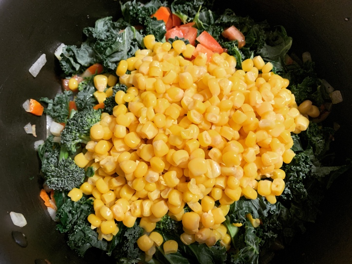 bright yellow corn in vegan corn chowder