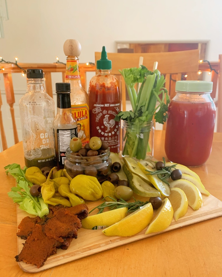 Plant-Based Bloody mary : pepperochinis, olives, lemons, vegan bacon, celery, hot sauce