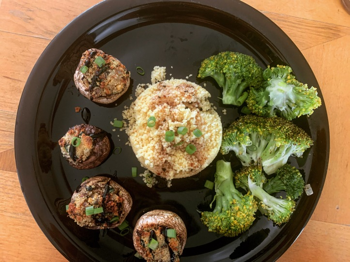vegan stuffed mushrooms garnished with balsamic glaze and green onions