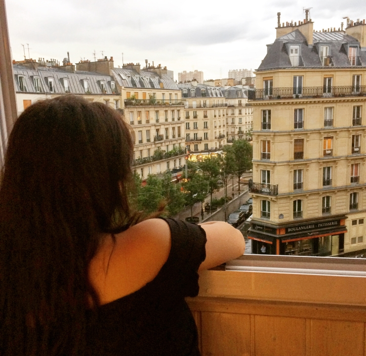 looking out a window in Paris france