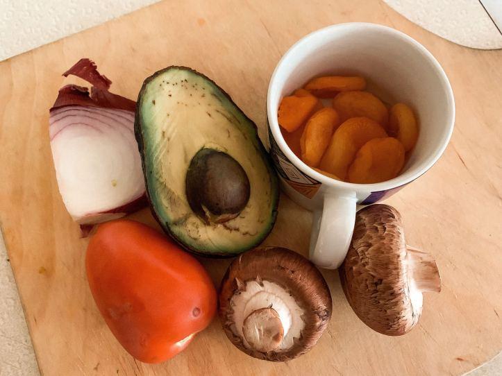 avocado, tomato, mushroom, red onion and apricot for plant-based salad