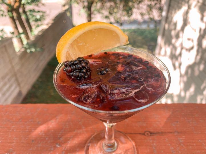 blackberry bourbon lemonade cocktail on the porch