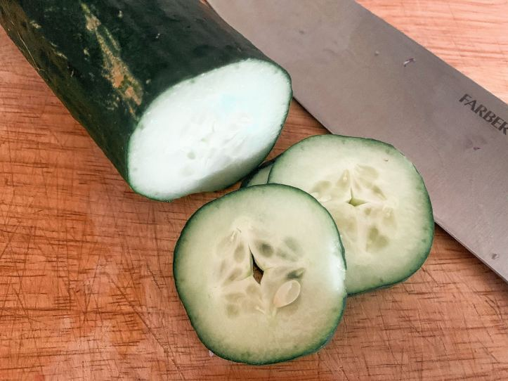 sliced cucumber for vegan greek orzo salad
