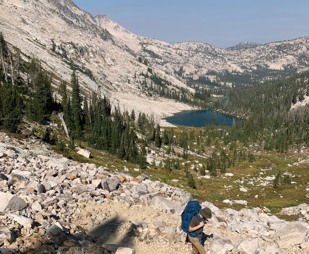hiking the steep rock fields to get to the top of the pass on Toxaway/ Alice Lake trail loop in the Sawtooths