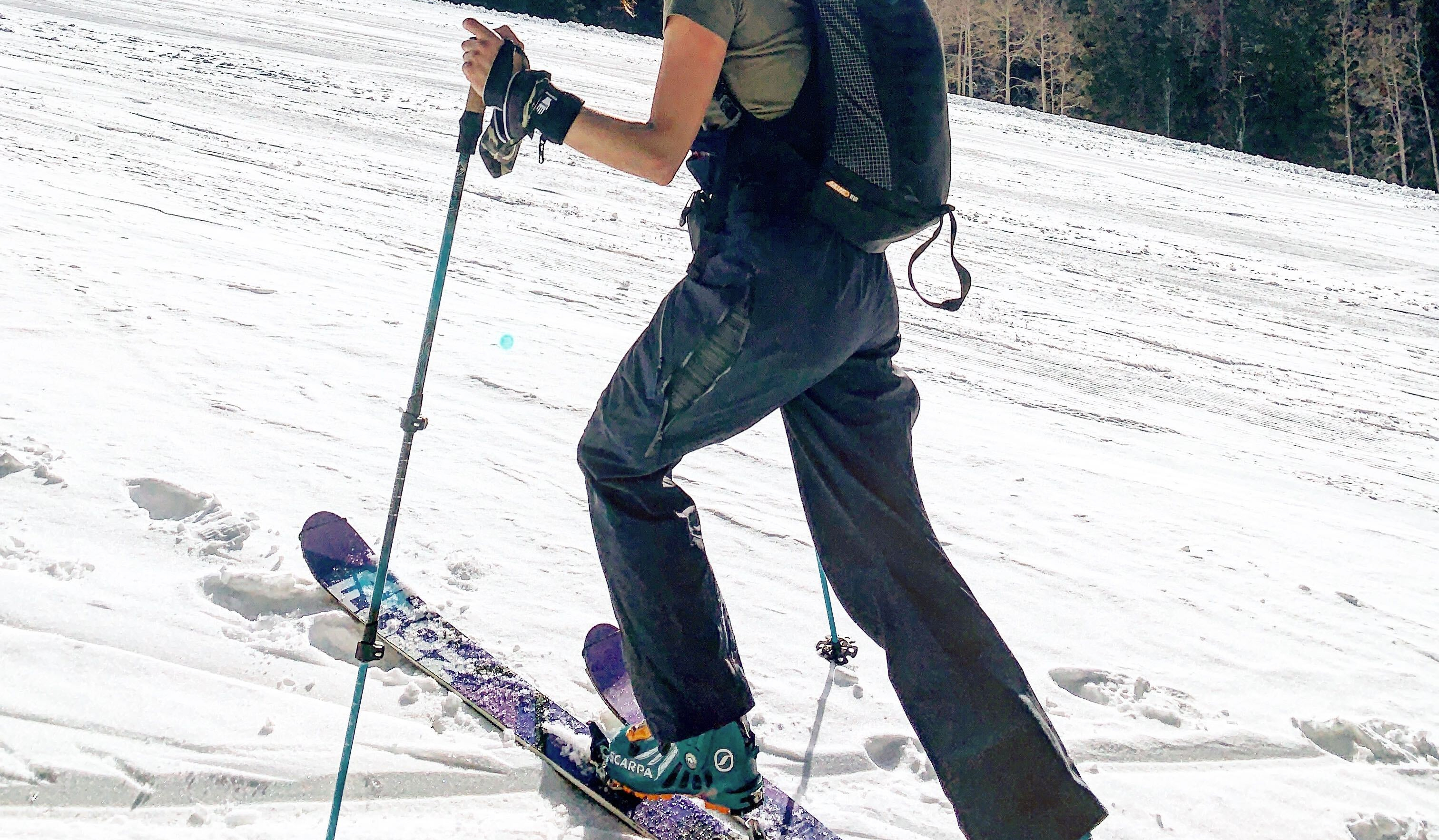 ski touring up a ski resort with uninsulated pants