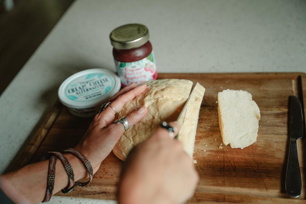 raspberry cream cheese vegan toast - slicing a piece of bread
