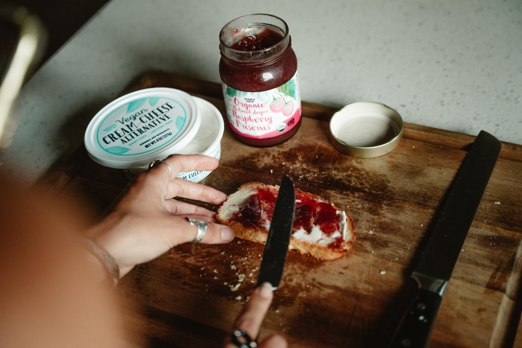 raspberry cream cheese vegan toast recipe - spreading raspberry preserves